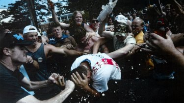 A young man is set upon during the 2005 Cronulla race riots.