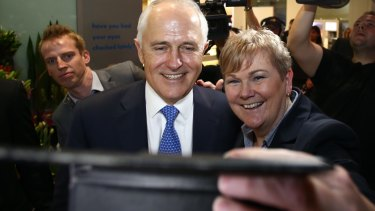 Prime Minister Malcolm Turnbull takes a selfie during the shopping centre visit.