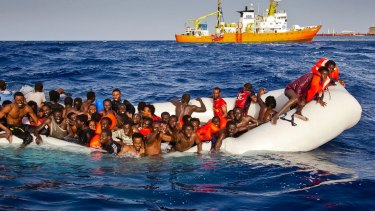 Migrants ask for help as they are approached by the SOS Mediterranee's ship Aquarius in April 2016.