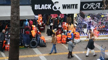 The busy commercial strip in Izmir, Turkey, where life vests and buoys are top selling items.