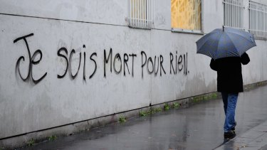 "Graffiti reading ""I died for nothing"" on a wall in Paris this week."