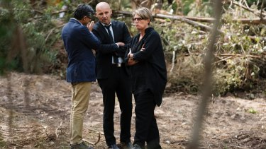 Detective Chief Inspector Gary Jubelin, centre, with Deputy Coroner Elaine Truscott  at the search site in the Royal National Park.