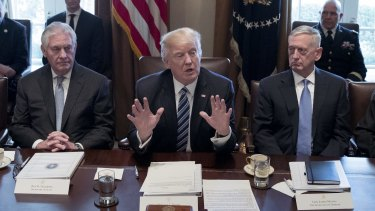 Donald Trump between James Mattis, US Secretary of Defence, right, and Rex Tillerson, US Secretary of State, on Monday.