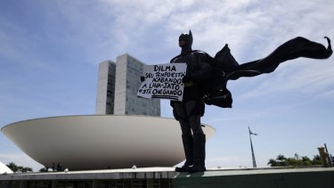 An anti-government demonstrator dressed as Batman protests against corruption at the National Congress in Brasilia.