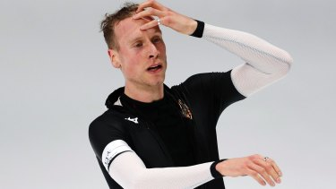 Germany's Moritz Geisreiter catches his breath after the men's 10,000 metres speedskating race at the Winter Olympics. He'll need a beer.