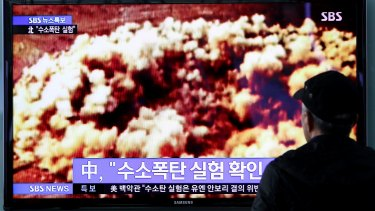 A television screen in Seoul shows a news broadcast about North Korea's nuclear test.