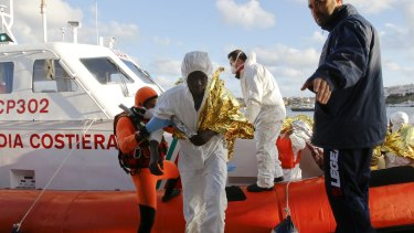 A survivor arrives at the Lampedusa harbour. Nine people were saved.
