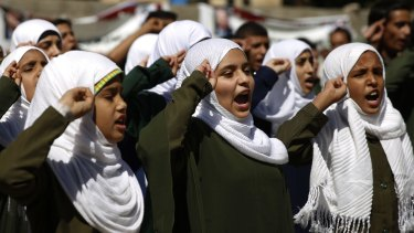 Yemeni students on Monday chant the national anthem at a protest in front of the UN in Sanaa to demand the Saudi-led coalition to stop targeting schools.