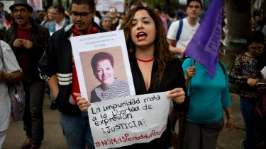 A woman shouts slogans holding a photo of Mexican journalist Miroslava Breach, gunned down in the northern state of Chihuahua.