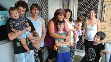 Lenore Lutanichi (centre) and her family at their Queensland housing commission house.