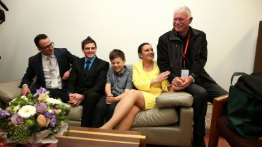 Independent senator Jacqui Lambie's son Dylan Milverton (second from left) was with family members at Parliament after Senator Lambie gave her first speech to the Senate last year.