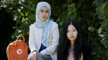 International students Fatim Amran and Naomi Zhao say they decided to study at ANU in Canberra after examining international rankings tables