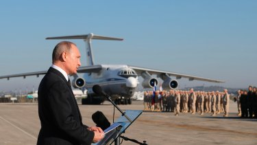 Russian President Vladimir Putin addresses the troops at the Russian-operated Hemeimeem air base in Syria on Monday.