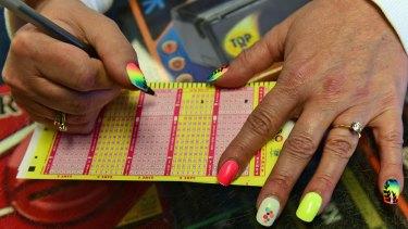 Money money money: Paula Hunt fills in Powerball numbers for a customer in Pennsylvania.