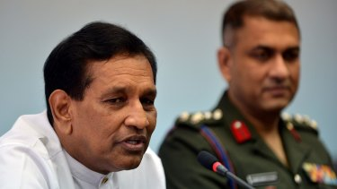 The Sri Lankan spokesman for President Maithripala Sirisena, Rajitha Senaratne, speaks as Army spokesman Brigadier Ruwan Wanigasooriya looks on.