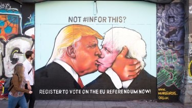 A mural that has been painted on a derelict building in Stokes Croft showing Donald Trump sharing a kiss with Boris Johnson.