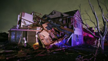 """""""Total devastation"""": Debris lies on the ground near a home that was heavily damaged by a tornado in Rowlett, Texas."""