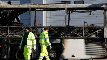 The gutted remains of the bus that crashed along the A4 highway in Verona, Italy.