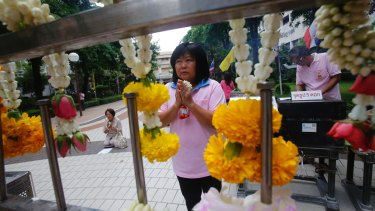 A woman prays at Siriraj Hospital where Thai King Bhumibol Adulyadej is being treated in Bangkok.