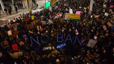 Thousands protest against the Muslim immigration ban at John F. Kennedy International Airport on January 28, 2017 in New York City.
