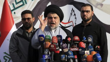 Shiite cleric Muqtada al-Sadr, speaks to his supporters and Arab media before entering the highly fortified Green Zone during protests in March.