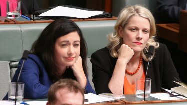 Labor MPs Terri Butler and Clare O'Neil listen during question time on Monday.