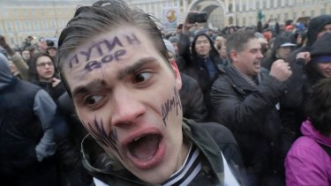 A young protester shouts slogans at Dvortsovaya (Palace) Square in St Petersburg on Sunday.