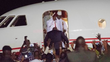 Yahya Jammeh's supporters watch as he enters the plane taking him from Gambia, where he has ruled since 1994.