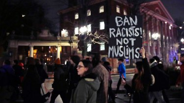 Several hundred people march through Harvard University while protesting the travel ban.