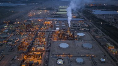 An oil sands plant in Alberta. Despite a severe economic downturn in the region, many energy companies have too much invested in the oil sands to turn off the taps.