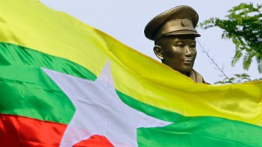The Myanmar national flag flies in front of a statue of General Aung San during a ceremony marking the 70th anniversary of his assassination in June.