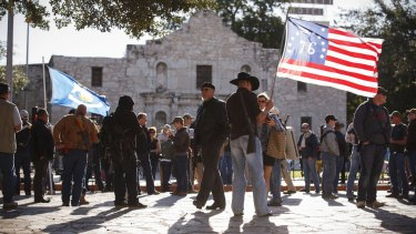 Demonstrators, some with rifles, gather for a pro-gun rally at the Alamo in San Antonio in October 2013.