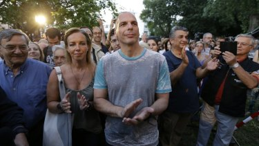 Greece's Finance Minister Yanis Varoufakis, centre, a dual Australian-Greek citizen, and his wife Danae Stratou applaud musicians during a concert at the state broadcaster ERT  following its re-launch on Thursday.