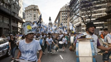 Supporters play musical instruments while waiting for the final polling results in Plaza de Mayo Square, near the campaign headquarters of presidential candidate Daniel Scioli in Buenos Aires on Sunday.