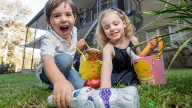 Jack and Charlotte Post fill their baskets on an early Easter Egg hunt in Sydney.