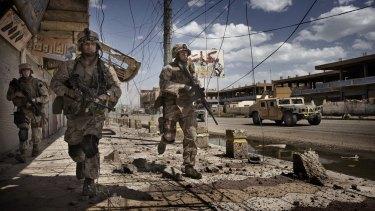 US Marines on patrol in Ramadi, 115 kilometers (70 miles) west of Baghdad, in 2006.
