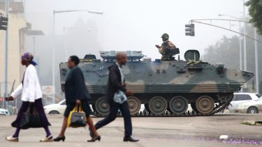 An armed soldier patrols a street in Harare, Zimbabwe on Wednesday.