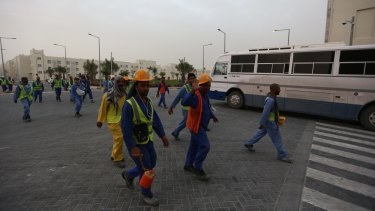 Workers at Al Rayyan Stadium in Doha, Qatar.