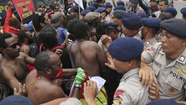 Unresolved conflict: Papuan activists scuffle with police during a rally marking the 53rd anniversary of the Free Papua Movement in Jakarta on December 1.