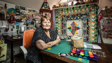 Jenny Rosalky in her sewing room filled with fabric and quilts, at her home in Stanmore, Sydney.