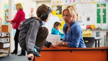 Teacher Jennifer Daverington talks with Talis about his behaviour.