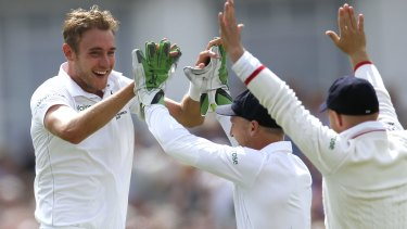 England's Stuart Broad celebrates after taking the wicket of Australia's Mitchell Johnson.
