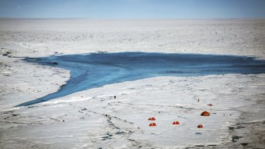 The researchers' camp near a supraglacial lake and river on the Greenland ice sheet in July.