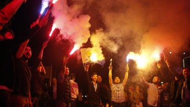 Supporters of Turkey's ruling Justice and Development Party celebrate on Sunday.