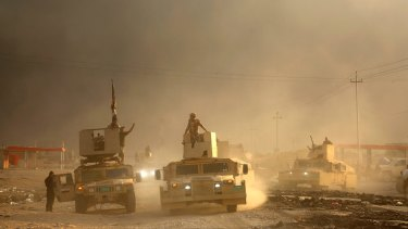 An Iraqi military convoy advances towards the city of Mosul, on Wednesday.