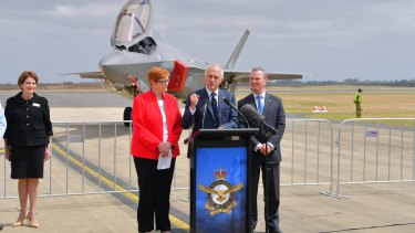 Malcolm Turnbull, Marise Payne and Christopher Pyne with the F-35 Joint Strike Fighter at Avalon. Lockheed Martin chief executive Marillyn Hewson on the left.