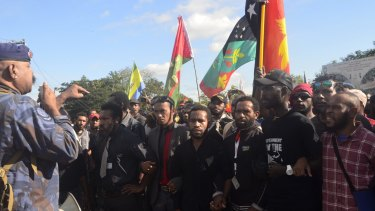 PNG PM Peter O'Neill (not pictured) said protesters threw rocks at police.