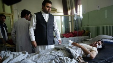Wounded men lie in Wazir Akbar Khan Hospital in Kabul, Afghanistan.
