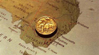 Economists expect Australia's currency to break out the bottom of its tight trading band, after the yield differential on Australian and US 10-year government bonds, a key gauge for where the currency will go, reached its lowest level in 17 years.