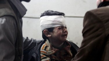 An child injured in an air strike by forces loyal to Syria's President  in Duma, Damascus.
